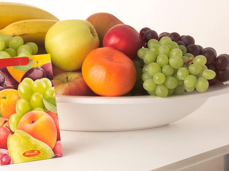 Декоративная ловушка с приманкой для плодовых мошек Aeroxon в действии